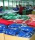 Darbas Olandijoje prie rūbų pakavimo, rūšiavimo